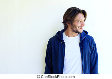 Smiling young man with beard looking away