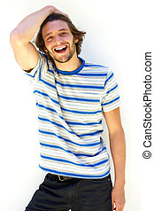 Smiling young man with hand in hair