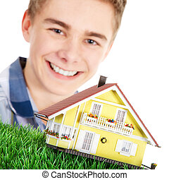 smiling young man with house