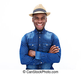 Smiling young man with laughing with arms crossed