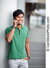 Smiling young man with mobile
