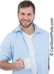 Smiling young model holding a mug