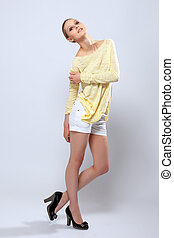 Smiling young model posing in casual clothes