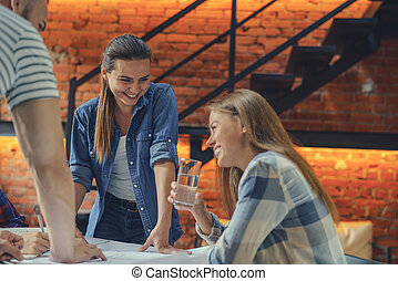 Smiling young people at work