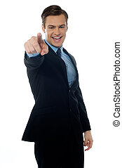 Smiling young professional pointing at you