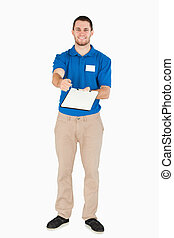 Smiling young sales assistant asking for signature against a...