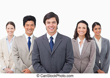 Smiling young sales team standing against a white background