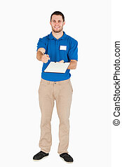 Smiling young salesman asking for signature