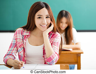 smiling Young  student with others  in the classroom