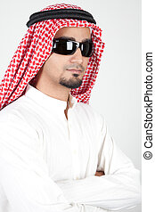 Smiling young success man, arabic traditional clothes wearing sunglasses