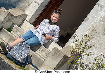 young teen girl sitting on the steps