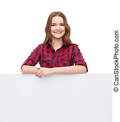smiling young teenage girl with white blank board - ...