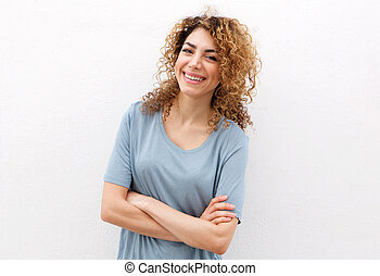 Smiling young woman against isolated white background