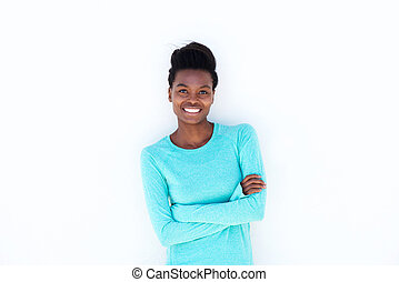 smiling young woman against white wall