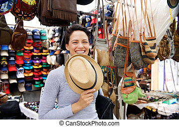 Smiling young woman at shopping market