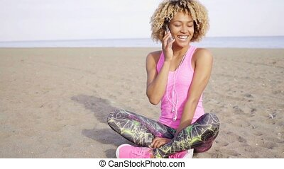 Smiling young woman chatting on a mobile phone