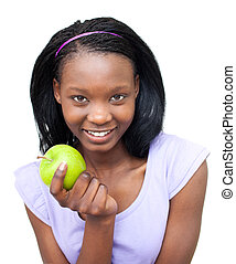 Smiling young woman eating an apple