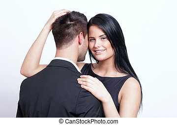 Smiling young woman embracing a man