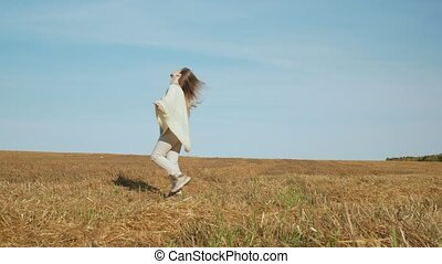 Smiling young woman enjoying nature on canted field. - Happy...