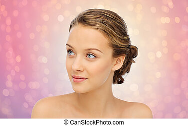 smiling young woman face and shoulders - beauty, people and...