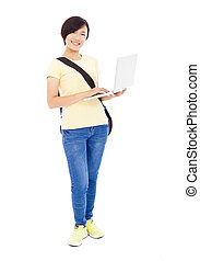 Smiling young woman holding a laptop and isolated on white