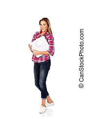 Smiling young woman holding a scale