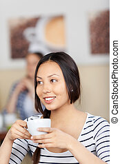 smiling young woman in a cafe