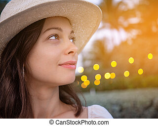 Smiling young woman in a hat