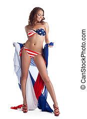 Smiling young woman in bikini with fabric