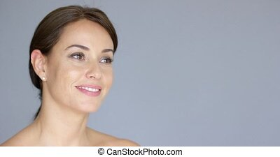 Smiling young woman in brown hair with copy space - Gorgeous...