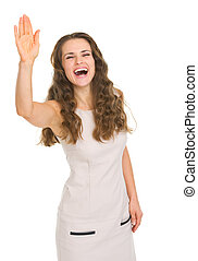 Smiling young woman in dress saluting