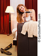 Smiling young woman in hotel