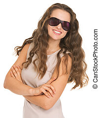 Smiling young woman in sunglasses