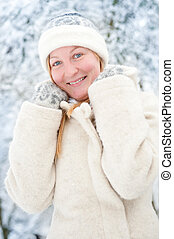 Smiling young woman in the snow