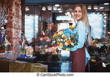 Smiling young woman in the store