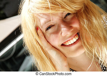 Smiling young woman in the sunlight