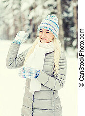 smiling young woman in winter forest