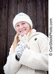 Smiling young woman in winter
