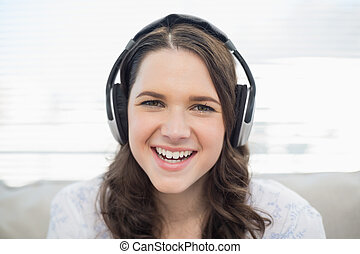 Smiling young woman listening to music