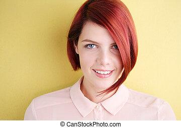 Smiling young woman looking at camera