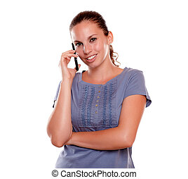 Smiling young woman looking at you on cellphone