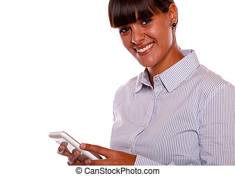 Smiling young woman looking at you with cellphone