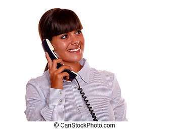 Smiling young woman looking left up with phone