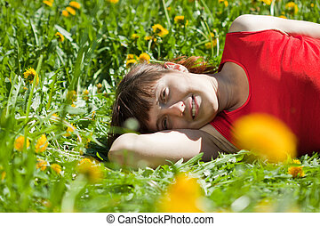 woman lying on meadow grass