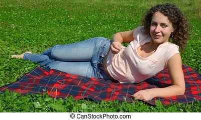 woman lying on summer field in park