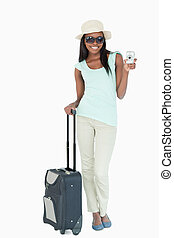 Smiling young woman making holidays abroad against a white...