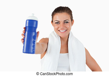 Smiling young woman offering a sip of water