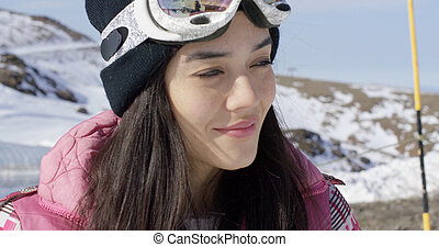 Smiling young woman on skiing holiday