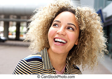 Smiling young woman outside