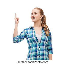 smiling young woman pinting finger up